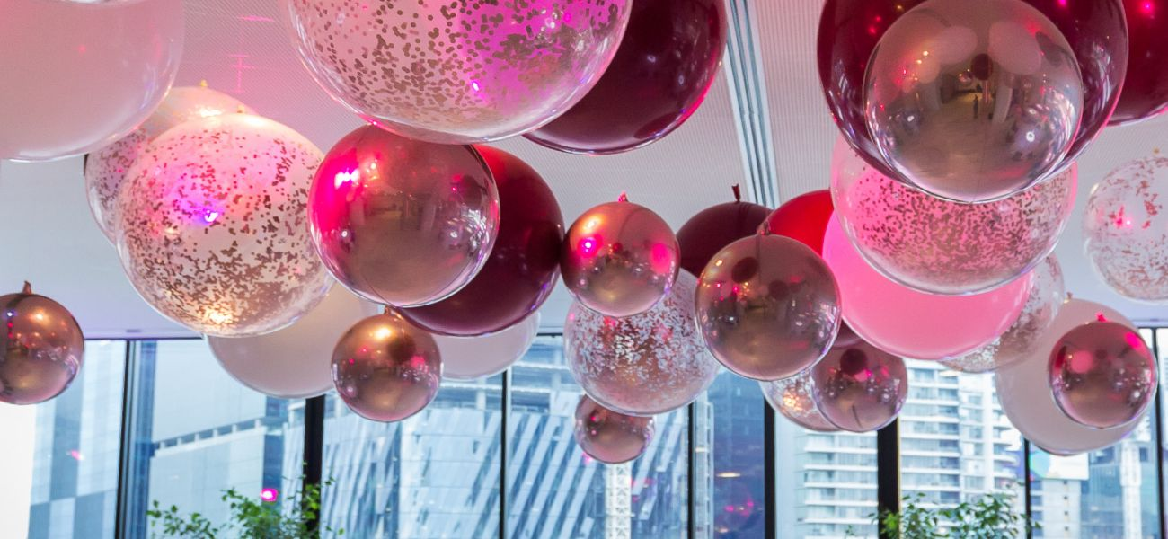 Pink balloons floating on ceiling