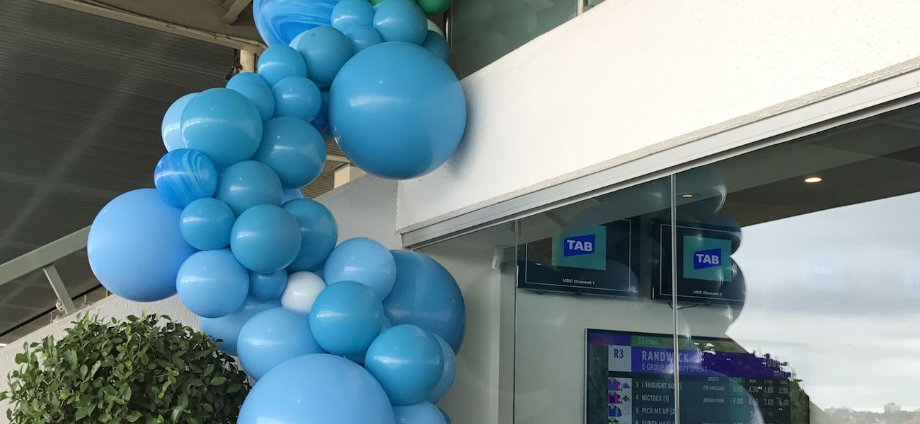 store opening blue balloon garland