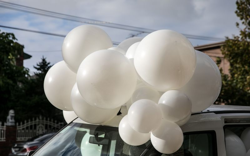 balloons falling out of car